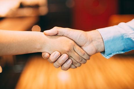 indoors-unrecognizable-gesture-shaking-handshake.jpg