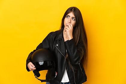 young-biker-holding-motorcycle-helmet (1).jpg