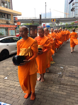 Offering food to the monks