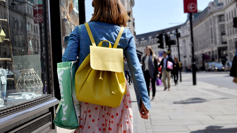 people walking down the street shopping