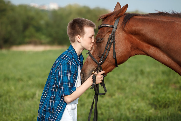 boy kissing horse.jpg