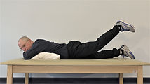 prone lying hip extension exercise