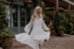 Image-Alt__Bride running in front of Gre