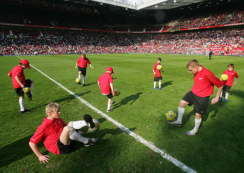 Joel performing in front of a capacity Old Trafford crowd