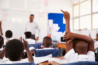 kids-raising-hands-to-answer-teacher-at-