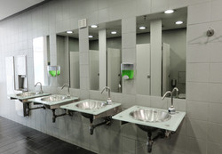 Row of cleaned sinks and taps