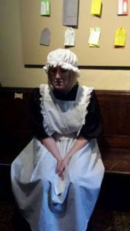 Emily the maid, sharing her distress as the audience walked by