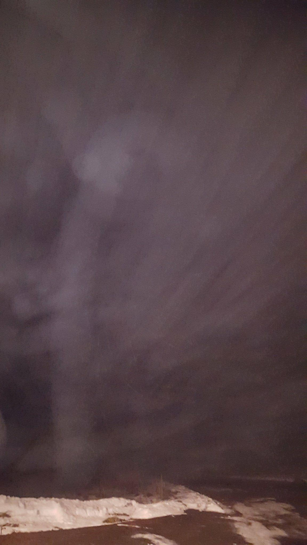 Pink fog with vertical shaft figure with eyes and nose.