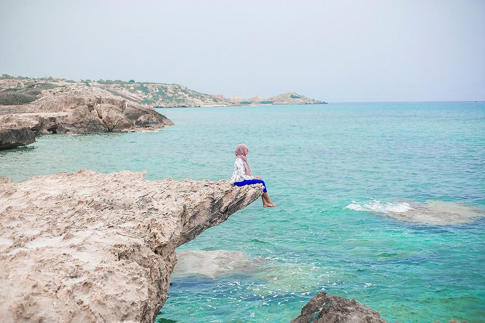 sitting on rocks Alagadi beach view
