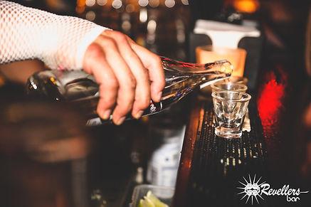 Revellers Bar Shots Pour