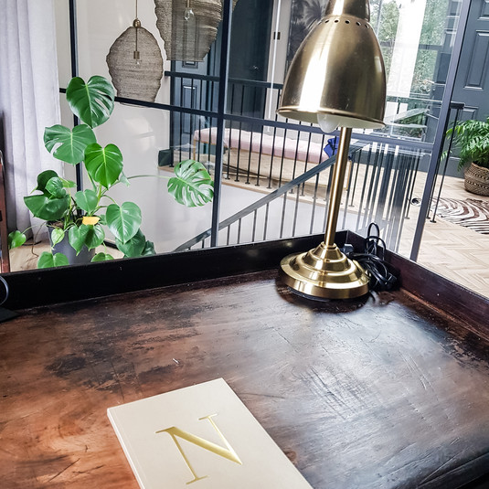 Adding an antique wooden desks gives a warmth and patina no new desk can challenge