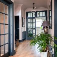 Hallway with dark grey woodwork