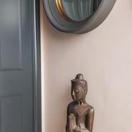 Round mirror with Buddha statue