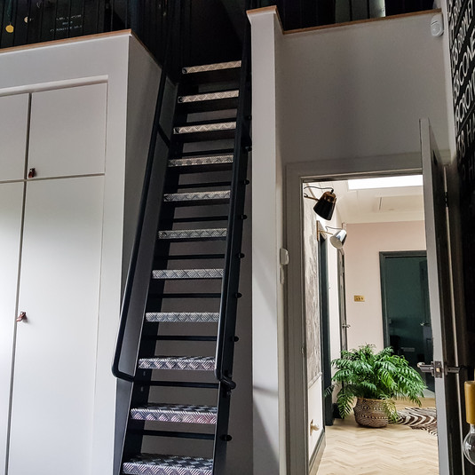 Industrial staircase up to mezzanine level