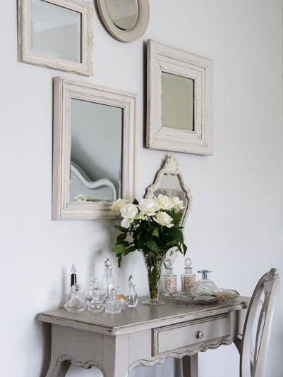 Collection of vintage mirrors above dressing table