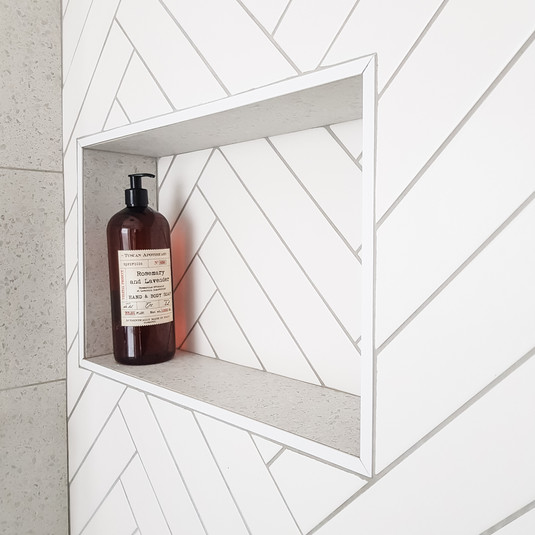 Build in a nook in the shower for a practical and stylish solution to housing showering essentials
