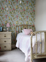 Antique French bed in girl's bedroom