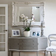 Painted sideboard with ornate mirror