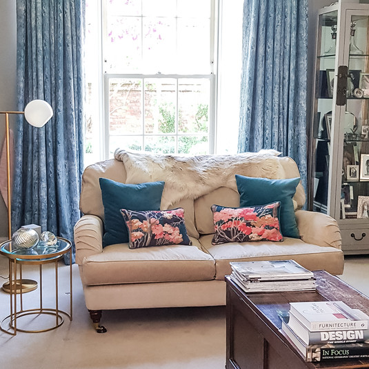 Cushions tie in the neutral backdrop with the colour on the curtains