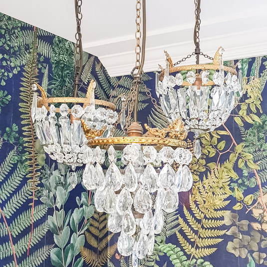 A collection of vintage chandeliers (in addition to the task focused lighting)