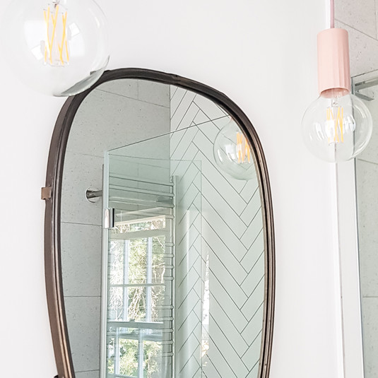 Contemprary pendant lights to add a bit of fun to the mirror