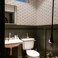 Black and white scheme lifted by the gold brassware