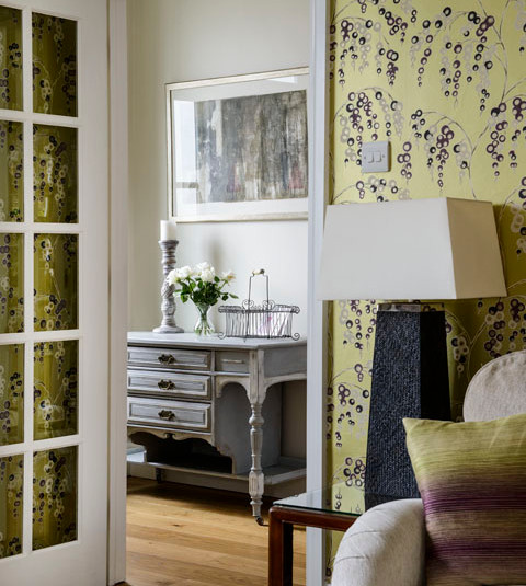 Wallpaper and cushions tying the scheme together