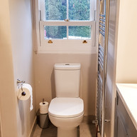 Tiny bedsit bathroom made calm and neutral