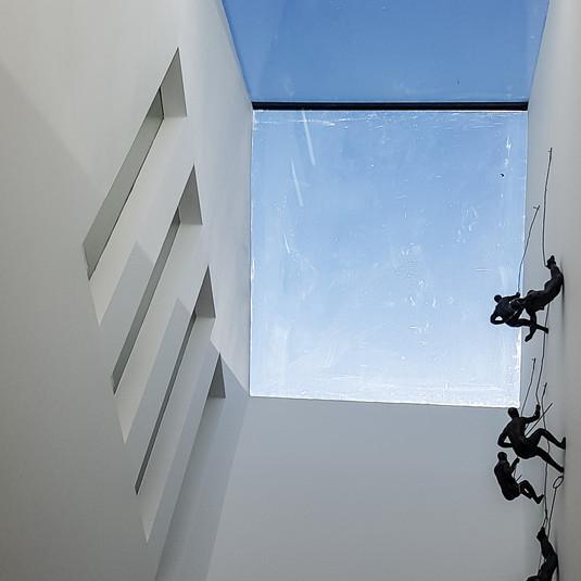 Skylight with internal windows for borrowed light