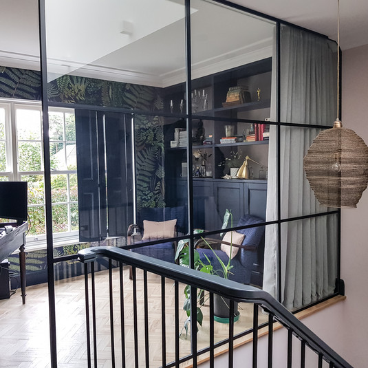 Open upstairs study with glass wall