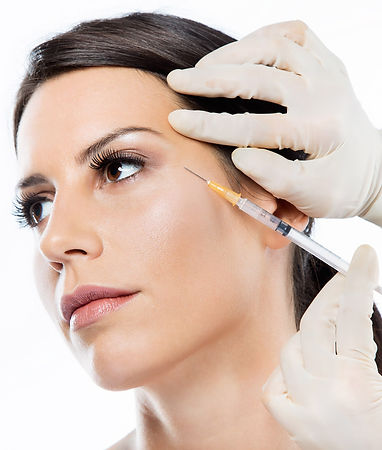 Beautiful young woman getting botox cosmetic injection in her face