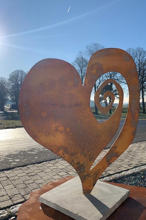 Herz auf Steinplatte