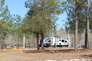 """Water and Electric RV sites available for daily, weekly, or monthly reservations! These sites are conveniently located near the """"Back Porch"""" and feature spacious sites with all of the hookups necessary to make your stay restful and relaxing!"""