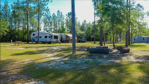"""Full service RV sites available for daily, weekly, or monthly reservations! These sites are conveniently located near the """"Back Porch"""" and feature spacious sites with all of the hookups necessary to make your stay restful and relaxing!"""