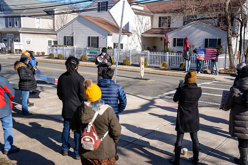 """A crowd of about 15 individuals gather outside Ramsey Borough Hall on Sunday, Jan. 24th, 2021 to protest the Ramsey Police Department for an alleged """"racial profiling"""" incident and charges delivered to Nick Haas after speaking out on the incident publicly. (Photo/Julian Leshay)"""