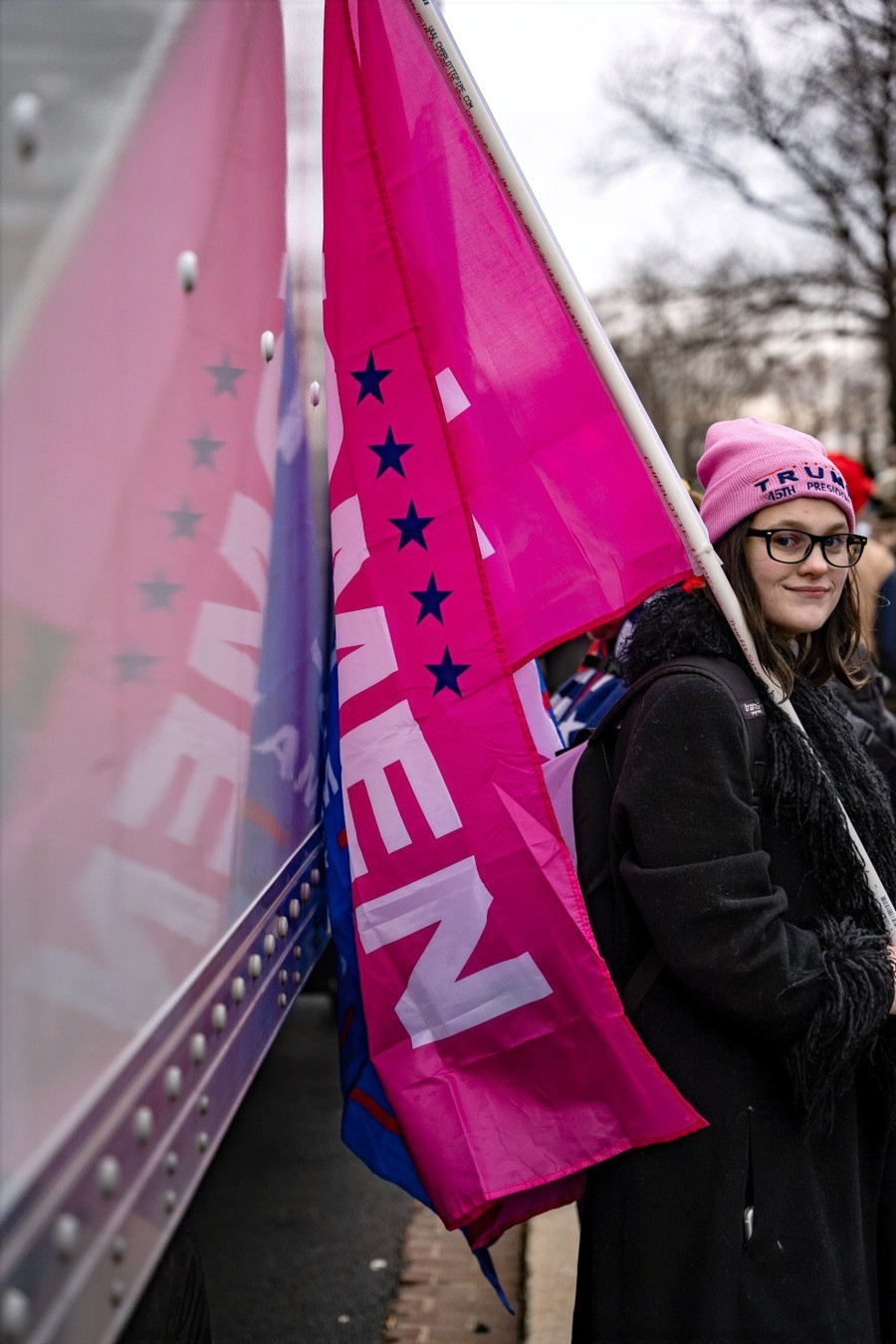 Trump supporter holding a Women for Trump Flag Tuesday, Jan. 5, 2021 in Washington, DC, in support of President Donald Trump. Photo: Julian Leshay