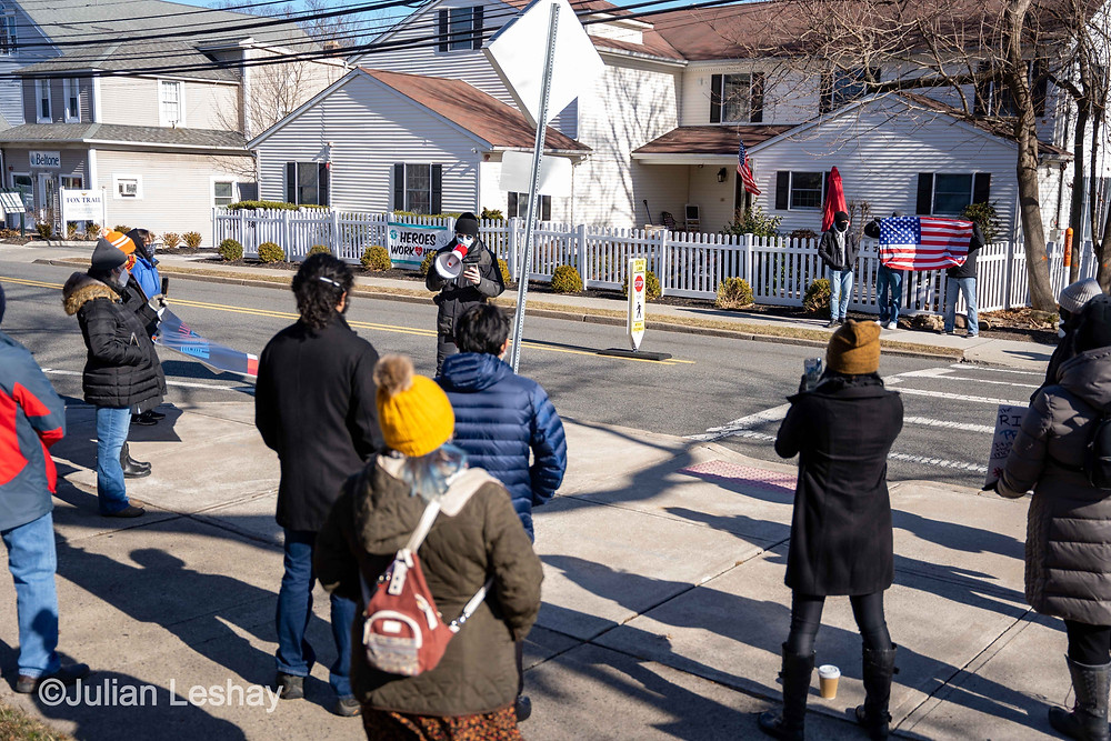 "A crowd of about 15 individuals gather outside Ramsey Borough Hall on Sunday, Jan. 24th, 2021 to protest the Ramsey Police Department for an alleged ""racial profiling"" incident and charges delivered to Nick Haas after speaking out on the incident publicly. (Photo/Julian Leshay)"