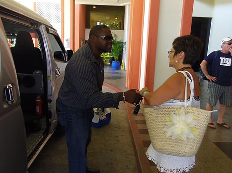 Alvin Andre' greeting guest of Sxm Bus Tours