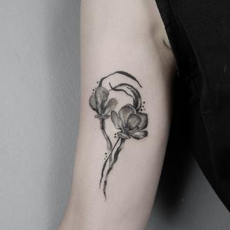 flowers and brush tattoo