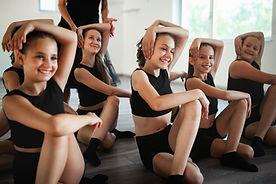 teacher-and-group-of-children-exercising
