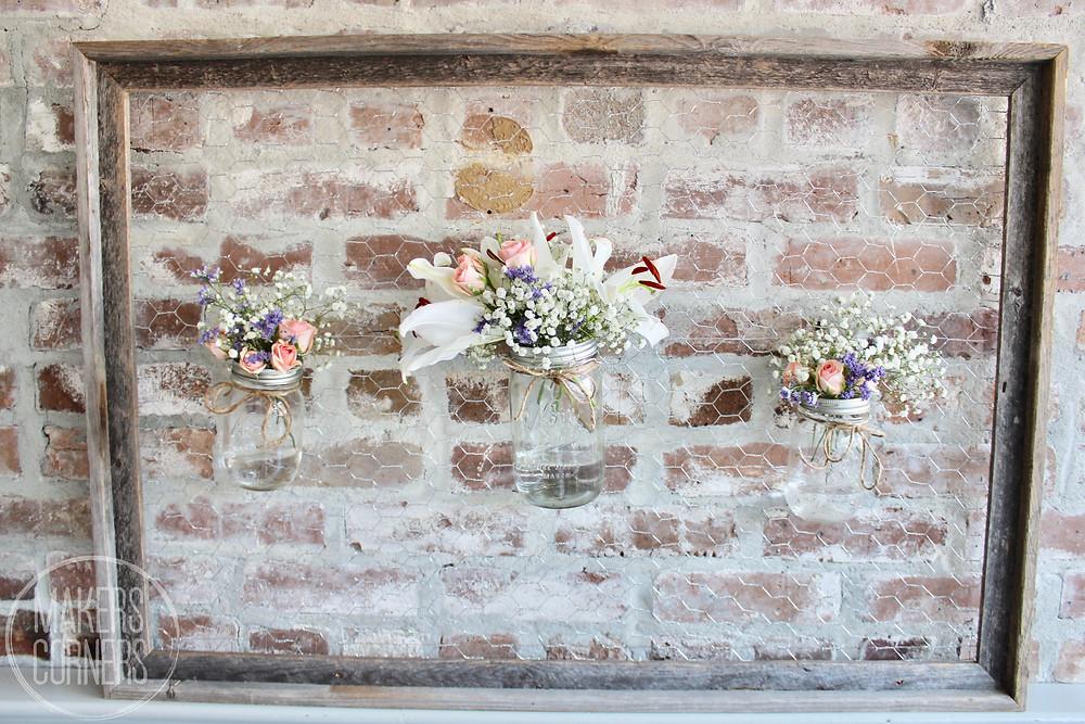 Chicken wire frame with flower mason jars