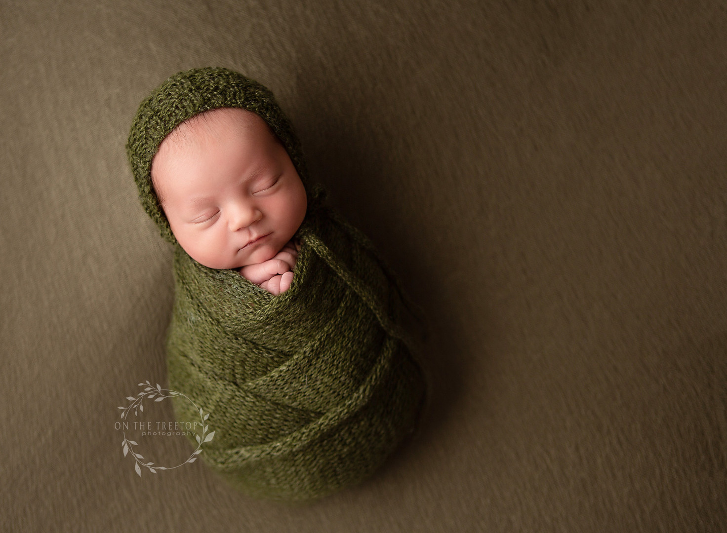 photograph of a swaddled newborn taken in Aliso Viejo California