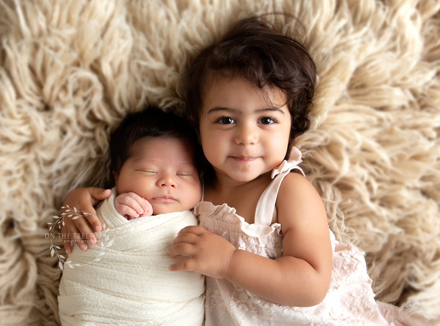 photograph of newborn boy and his proud big sister