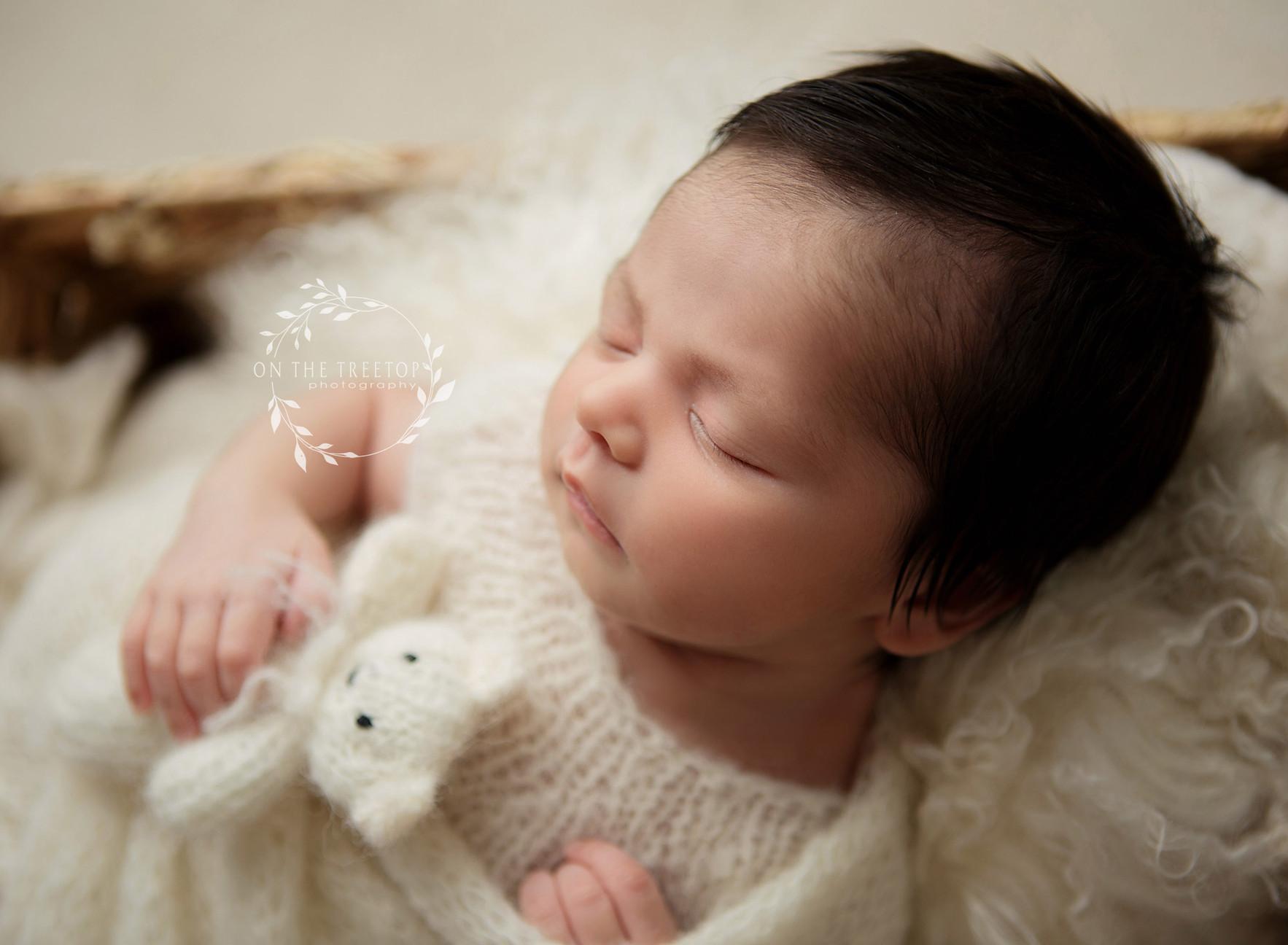 newborn profile-photograph with tiny bear