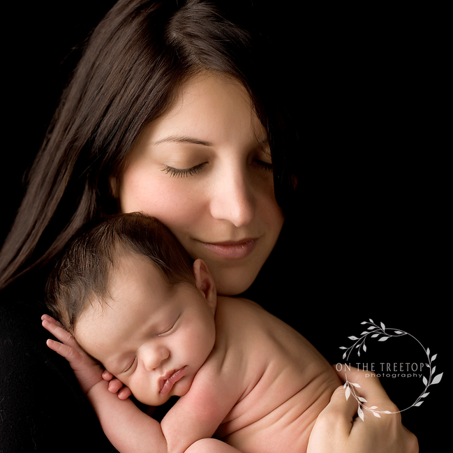 mom and her newborn baby girl photograped in home