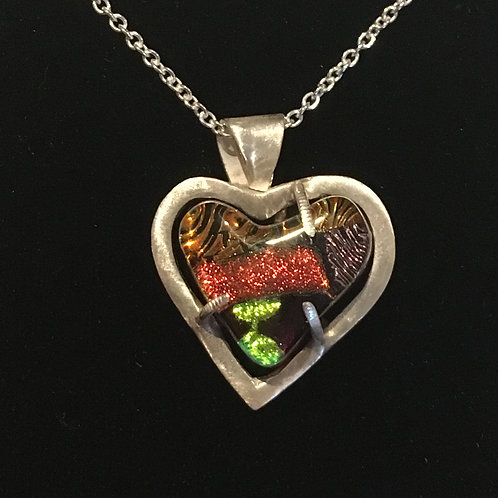 Dichroic glass heart in handmade eco-silver claw setting