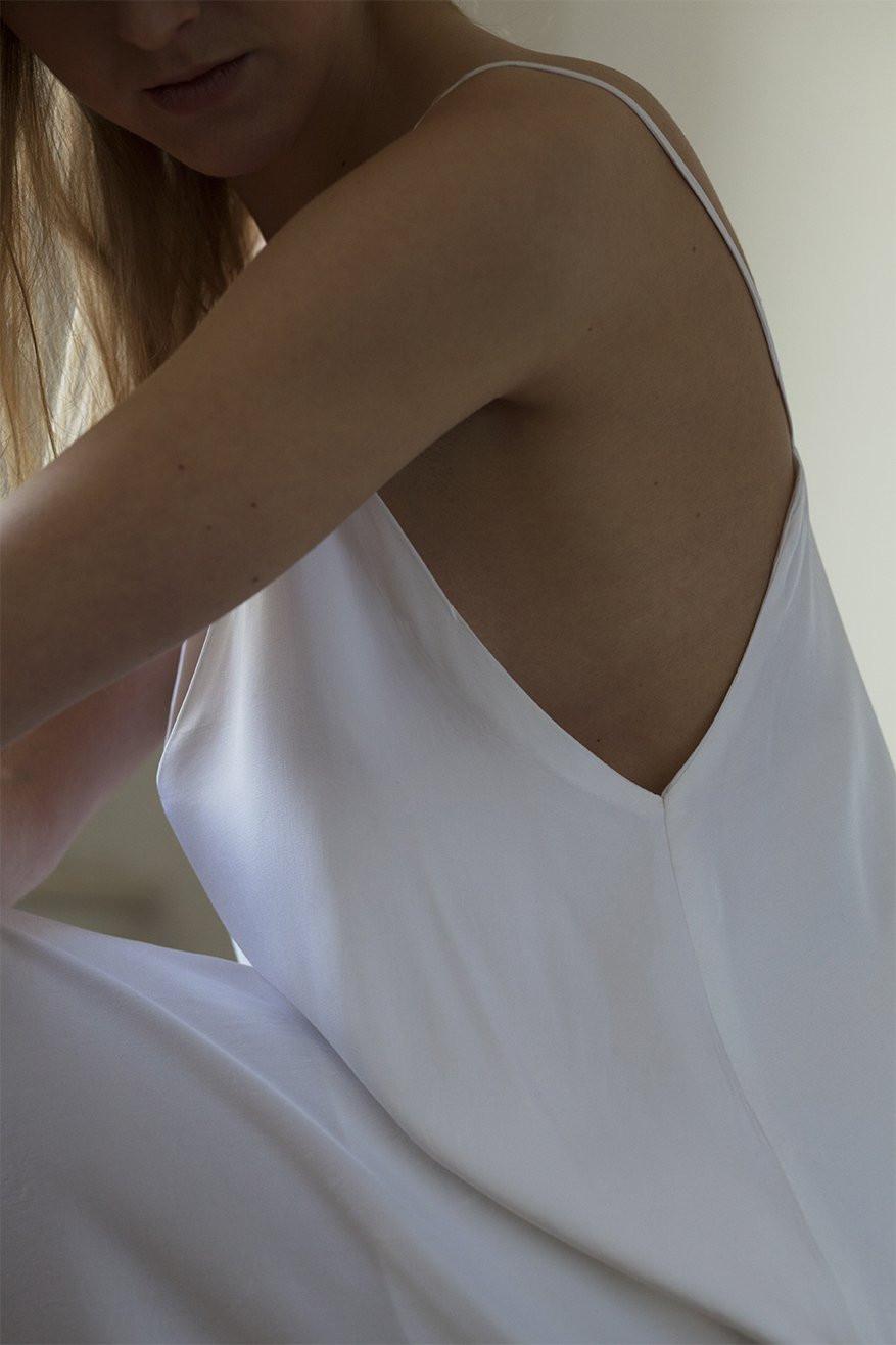 Closeup of a model hugging her knees