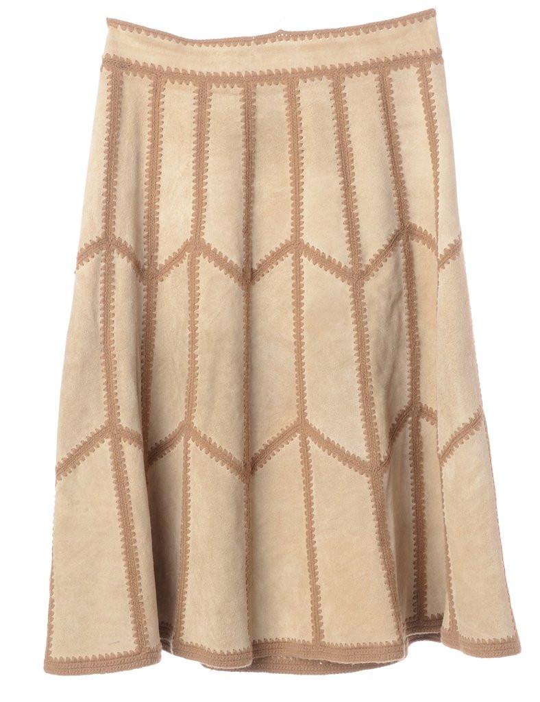 a beige skirt with darker brown ornament