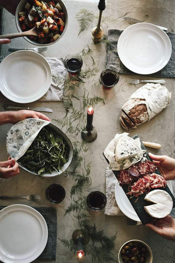 A table with various dishes and food wrapped in beeswax wrap