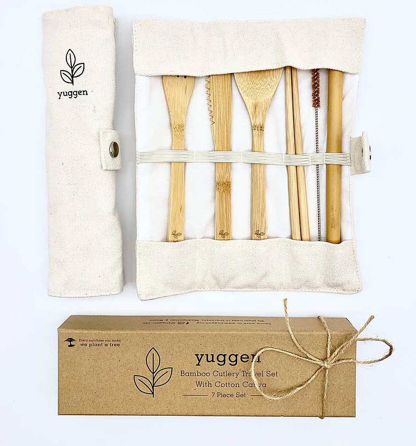 A box, a pouch and a cutlery set displayed flat. The pouch is displayed closed and open with a fork, knife, spoon, chopstick, brush and a straw